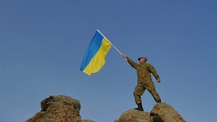 Soldier  waves Ukrainian Flag on mountain top, in Slow Motion  Stock Footage