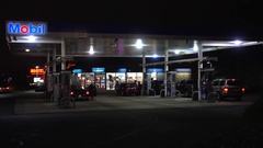 4K Mobil gas station fuel pump customers, convenience store Stock Footage