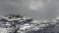 Clouds moving over the glaciers on the summit of Cotopaxi Volcano Stock Footage