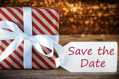 Atmospheric Christmas Gift With Label, English Text Save The Date Stock Photos