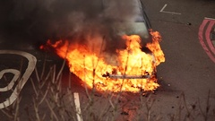 Car being engulfed by flames after accident Stock Footage