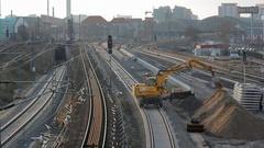 Earthmover on railroad train tracks moves soil, Berlin, Germany Stock Footage