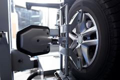 Car wheel fixed in alignment machine clap Stock Photos