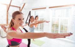 Three happy women standing in gym Stock Photos