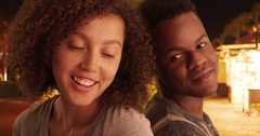 Black man and woman lean on each other on the streets Stock Footage