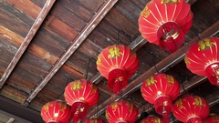 Traditional Chinese New Year Lanterns in small wooden temple Stock Footage