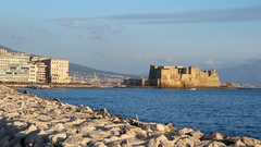 Castel dell Ovo at sunset in the bay of Naples italy Stock Footage