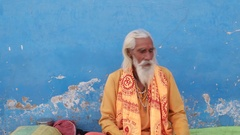 Hindu sadhu, holy man,  sitting and talking to people off camera in Pushkar, Raj Stock Footage
