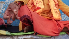 Old Indian sadhu, saint, sitting and meditation with closed eyes near a temple i Stock Footage