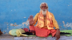 Sadhu baba, Indian holy man, giving blessings with his right hand raised in Push Stock Footage