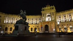 Statue in front of Hofburg palace in Vienna at night Stock Footage