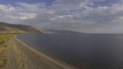 Aerial view of lake Sevan in Armenia, coastline and beautiful mountains Stock Footage