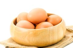 Chicken eggs in a wooden bowl Stock Photos