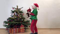Little child arrange ornament on Christmas tree Stock Footage