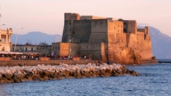 Naples panoramic view of Castel dell Ovo at sunset in the bay of Naples italy Stock Footage
