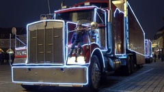 Little child sitting on big truck, in the city Christmas time Stock Footage