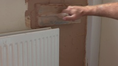 Plasterer plastering interior wall Stock Footage