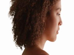 Close-up of African American millennial girl with curly hair on white background Stock Footage
