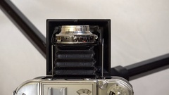 Hand fixing old photo camera lens Stock Footage