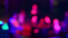 Blurred silhouettes of people dancing in a nightclub the light flashes Stock Footage