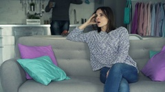 Attractive young couple arguing on sofa at home, 4K Stock Footage