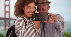 Young black couple celebrate their engagement near the Gold Gate Bridge Stock Footage