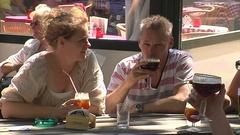 Three people drinking Belgian beer Stock Footage