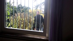 Burglar trying to get into a window which has iron bars Stock Footage