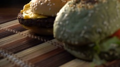 Three big tasty cheeseburger on the table Stock Footage