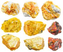 Set of various orpiment minerals isolated Stock Photos
