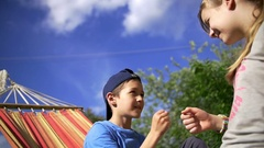 Children playing rock-paper-scissors, slow motion Stock Footage