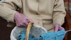 Closeup of older woman knitting a scarf Stock Footage