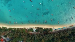 Aerial: Looking down at the Rawai beach with long tail boats. Stock Footage