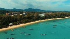 Aerial: Rawai beach panorama with long tail boats. Stock Footage
