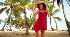 Young black girl dances in a sun dress on the beach Stock Footage