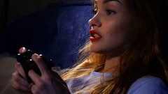 Girl with red lips plays computer games Stock Footage