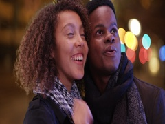 Young African American couple admire the nightlife of the city Stock Footage