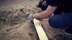 Man collecting new children's sandbox Stock Footage