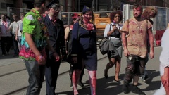 Horde of zombies crossing the street - zombie on wheelchair Stock Footage