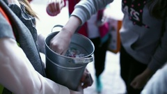 Children taking candy from a bucket Stock Footage