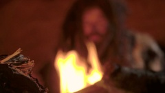 First fire made by prehistoric caveman in his cave Stock Footage