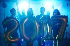 Joyful friends enjoying new year party in night club Kuvituskuvat