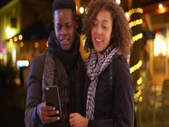 Millennial black couple call a taxi with their smart phone Stock Footage