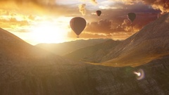 Aerial Flight Over Hot Air Baloons in a Mountain Range at Sunset Beautiful Stock Footage