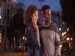 Young black couple admire something on the street in San Francisco Stock Footage