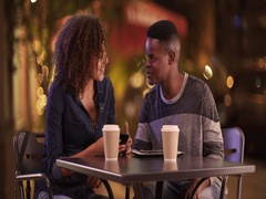 Young African American couple have coffee at night in the city Stock Footage