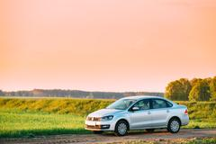 Volkswagen Polo Car Parking On Wheat Field. Sunset Sunrise Sky O Stock Photos