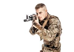 Young serviceman aiming with rifle Stock Photos