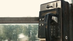 Old black rusty phone in phone booth coin Stock Footage