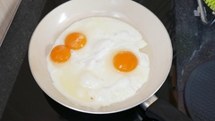Eggs Being  Fried In Hot Oil white pan Stock Footage